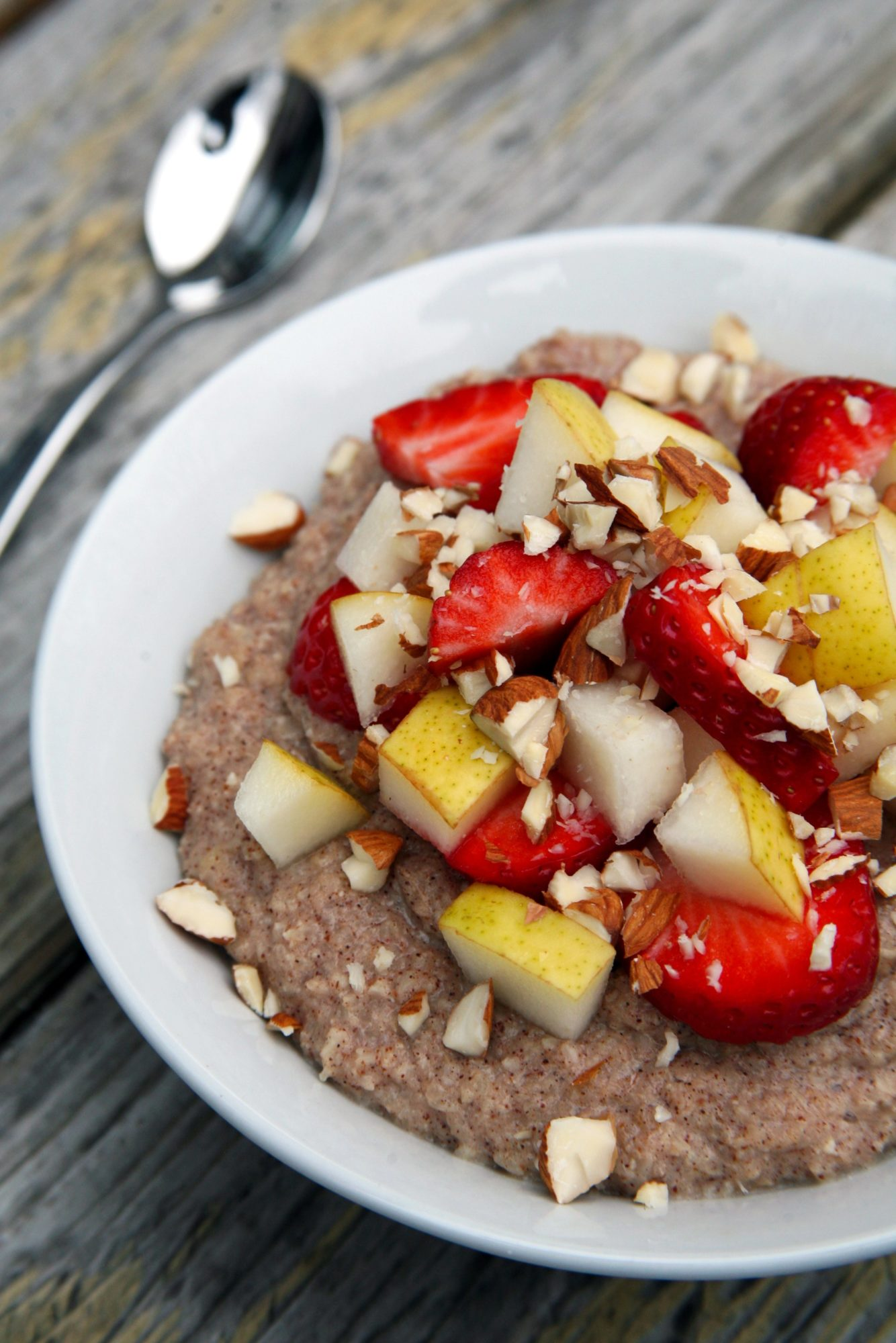 Cinnamon Cauliflower Oatmeal with Almond Butter, Strawberries and Pears